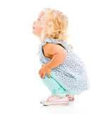 Little girl sitting Stock Photo