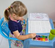 Free Little Girl Sitting Drawing With Watercolors In The Children`s Coloring. Stock Photo - 128088900