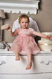 Little girl sitting on the dresser Stock Image