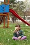 Little girl sitting eat ice cream Royalty Free Stock Photography