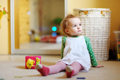 Little girl sitting on the floor Royalty Free Stock Photo