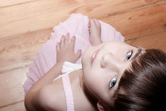 Little girl sitting on the floor Royalty Free Stock Photography