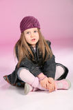 Little girl sitting on floor Stock Image