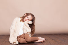 Little girl sitting on the floor and sad Royalty Free Stock Photo