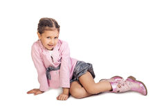 Little girl sitting on the floor Royalty Free Stock Image