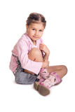 Little girl sitting on the floor Royalty Free Stock Photos