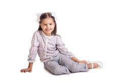 Little girl sitting on the floor Stock Image