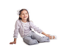 Little girl sitting on the floor Stock Photo