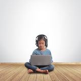 Little girl sitting on the floor with using laptop computer Stock Photography