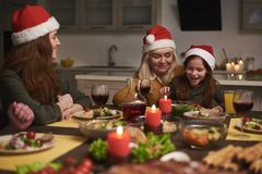 Little girl sitting with granny at festive dinner stock images