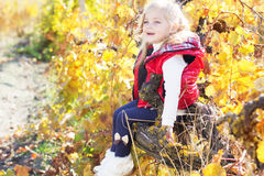 Little girl is sitting on the grape branch Stock Photography
