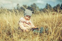 Little Girl Sitting on the Grass Royalty Free Stock Images