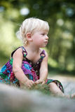 Little girl sitting on the ground Royalty Free Stock Photo