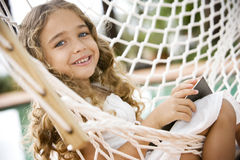 little girl sitting in a hammock stock image