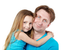 Little girl, sitting on hands of father Stock Images