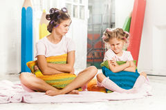 Little girl sitting with her mother Stock Photo