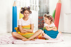 Little girl sitting with her mother Royalty Free Stock Images