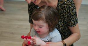 She Loves Raspberries. Little girl sitting on her mothers lap eating raspberries off the tips of her fingers stock video