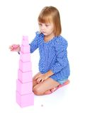 Little girl sitting on his lap builds high pink Royalty Free Stock Photos