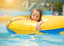 Little girl sitting on inflatable ring Royalty Free Stock Photos