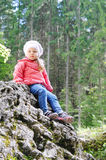 Little girl sitting on little mountain Royalty Free Stock Photo