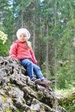 Little girl sitting on little mountain Royalty Free Stock Photo
