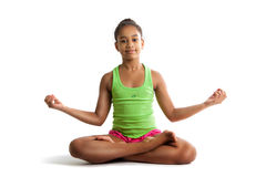 Little girl sitting in lotus position and hands up isolated on white background Stock Images