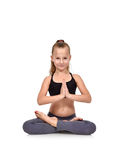Little girl sitting lotus position Stock Photo