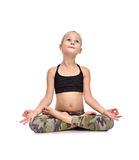 Little girl sitting lotus position Royalty Free Stock Photos