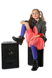 A little girl is sitting on a loudspeaker Stock Photography
