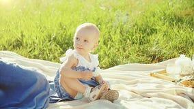 Little girl sitting in a meadow. stock video