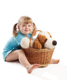 Little girl sitting  near basket Royalty Free Stock Photos