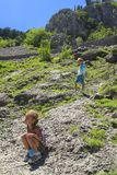 Little Girl Sitting On A Mountainside Not Far Above Is Serene He Royalty Free Stock Photos