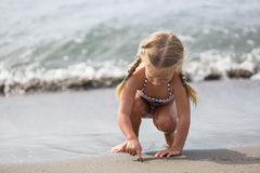 Free Little Girl Sitting On The Beach Royalty Free Stock Images - 65148899