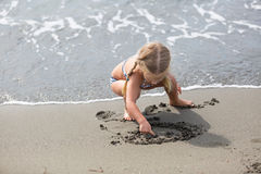 Free Little Girl  Sitting On The Beach Stock Image - 65149291