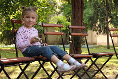 Little girl sitting in the  park Stock Image