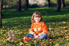Little girl sitting in park Stock Photography