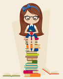Little girl sitting on a pile of books Royalty Free Stock Images