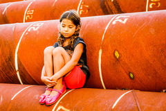 Little girl sitting in the pipe. Little girl is sitting in the pipe royalty free stock images