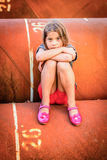 Little girl sitting on pipes Royalty Free Stock Images
