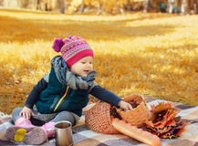 Little girl sitting on a plaid. Stock Photo