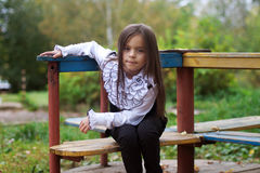 Little girl sitting on the playground Royalty Free Stock Photography