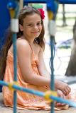 Little girl sitting on the playground Royalty Free Stock Photos