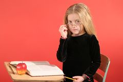 Little girl sitting in school Royalty Free Stock Images
