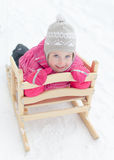Little girl sitting in sled Stock Images