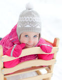 Little girl sitting in sled Stock Photography