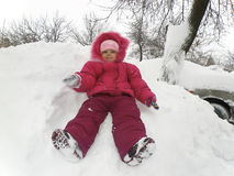 Little girl sitting in the snow Royalty Free Stock Photo
