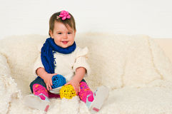 Little girl sitting on a sofa Royalty Free Stock Photos