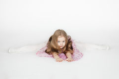 Little girl sitting on the splits Royalty Free Stock Photography