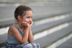 Little girl sitting on stairs Royalty Free Stock Image